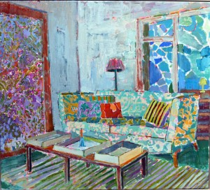 The green sofa next to the window