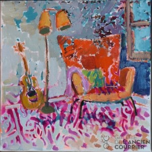The guitar next to the chair